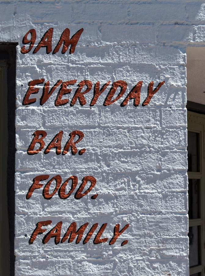 Unusual sign, bar and food. Everyday, bar, food, family. Unusual signage outside commercial eatery stock images