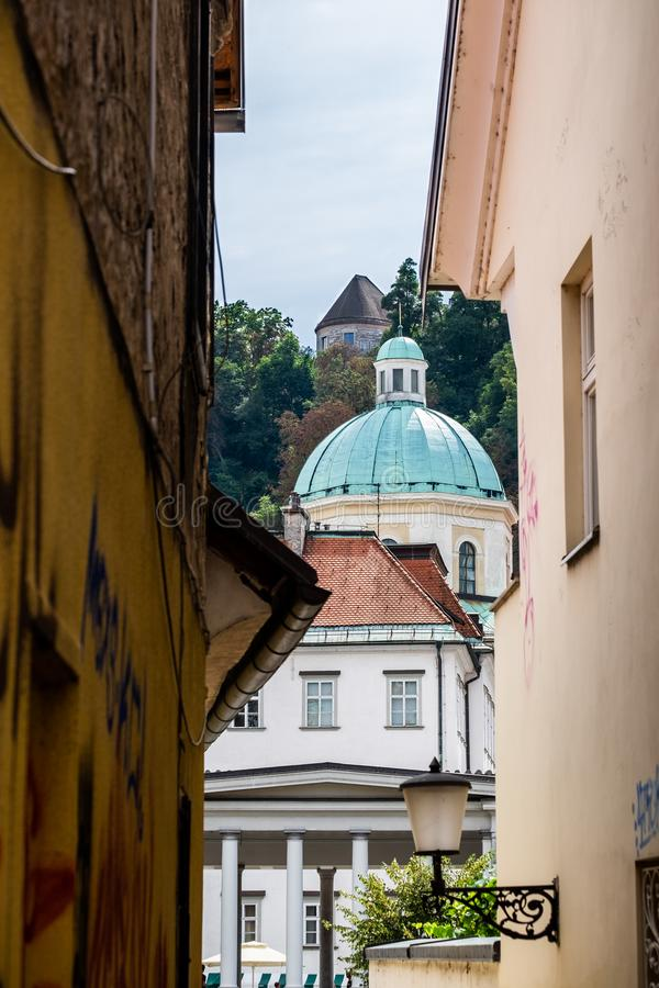 Unusual view on Ljubljana Cathedral (St. Nicholas's Church), also named St. Nicholas' Cathedral. Slovenia royalty free stock photography