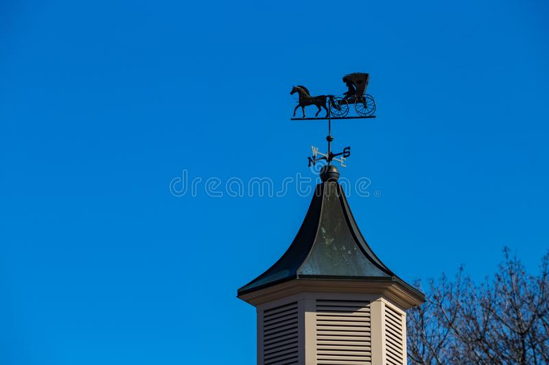 Weather Vane Amish Buggy. An unusual weather vane features an Amish Buggy royalty free stock photos