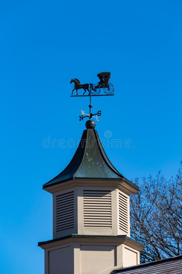 Amish Buggy Weather Vane. An unusual weather vane features an Amish Buggy stock photography