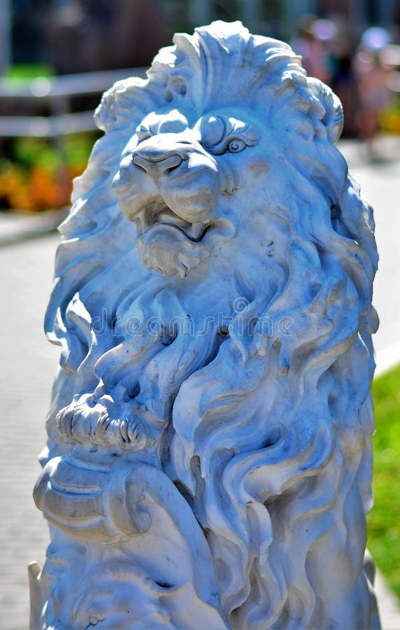 Unusual white stone lion. royalty free stock images