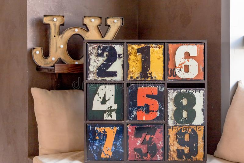 Unusual wooden furniture. trendy interior item for creative home design.wooden inscription Joy. old funny decorative royalty free stock images