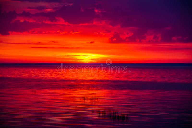 An unusually beautiful fire sunset by the sea. Sunset on the Gulf. Sunset at the sea. stock photography