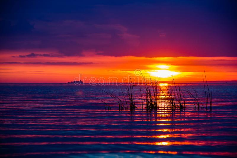 An unusually beautiful fire sunset by the sea. Sunset on the Gulf. Sunset at the sea. stock image