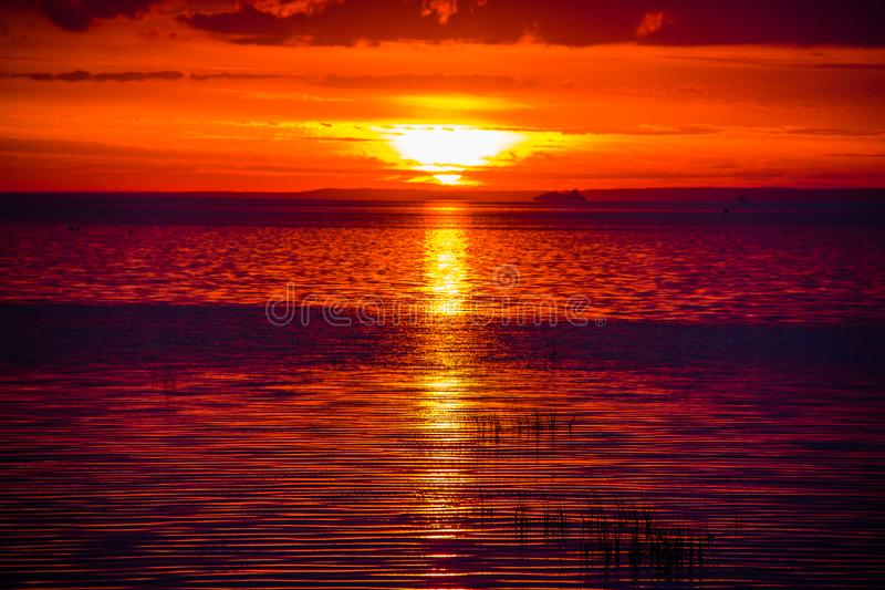 An unusually beautiful fire sunset by the sea. Sunset on the Gulf. Sunset at the sea. stock images