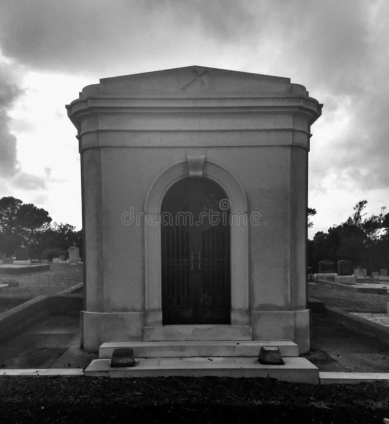 Unusually creepy day at the Cemetary. A black & white photo taken on an unusual creepy day at the cemetery royalty free stock photos