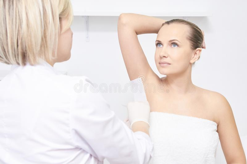 Unwanted hair wax epilation. Young Woman. cosmetology salon treatment procedure. Home waxing.  royalty free stock images