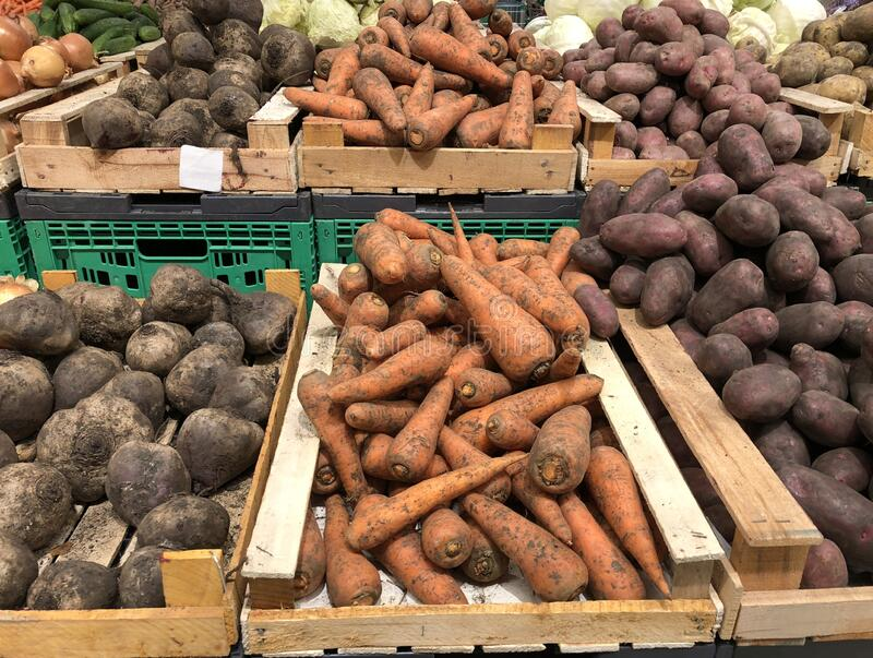 Unwashed carrots, beets and potatoes in a supermarket stock photo