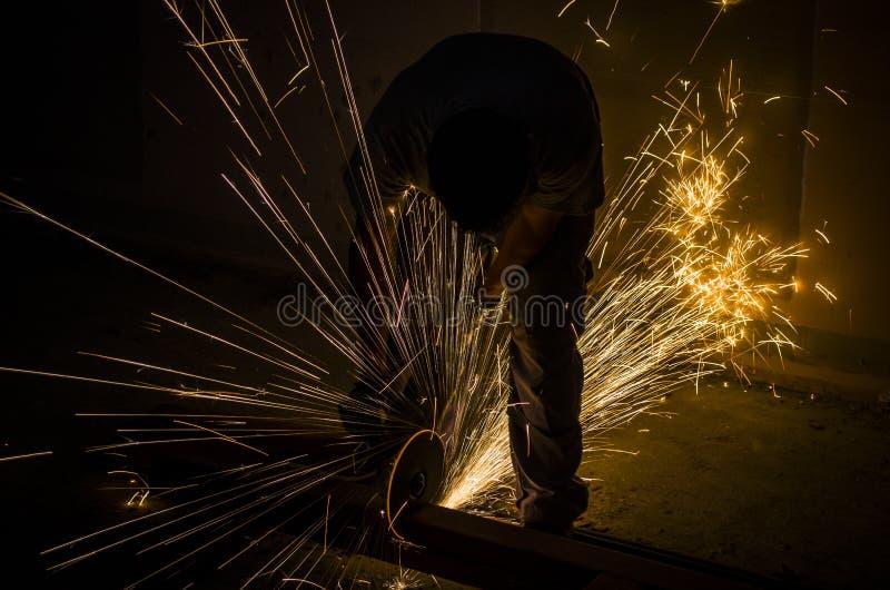 Uomini all'acciaio stridente del lavoro fotografie stock libere da diritti