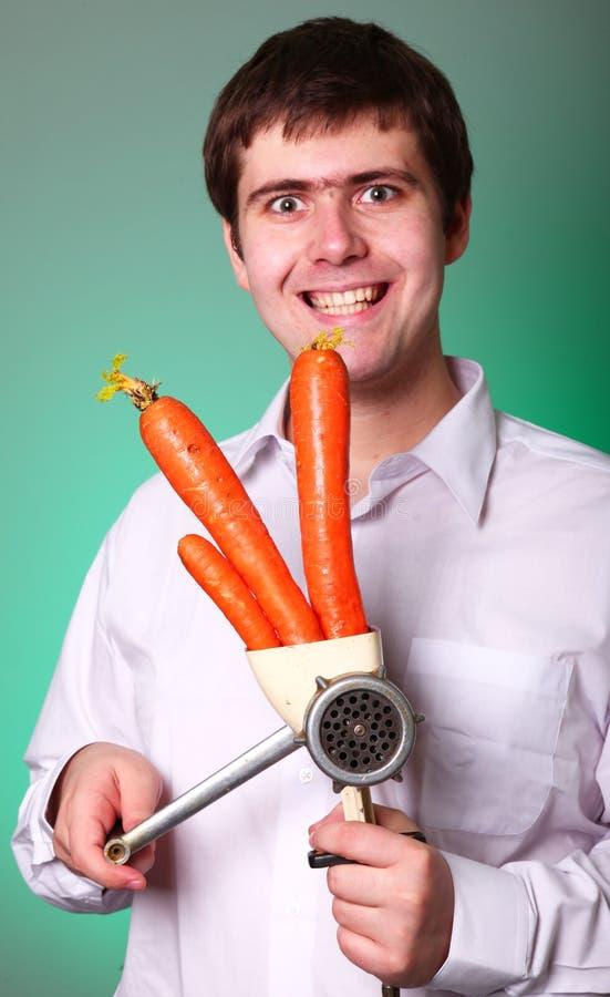 Uomini con il selettore rotante e la carota fotografia stock
