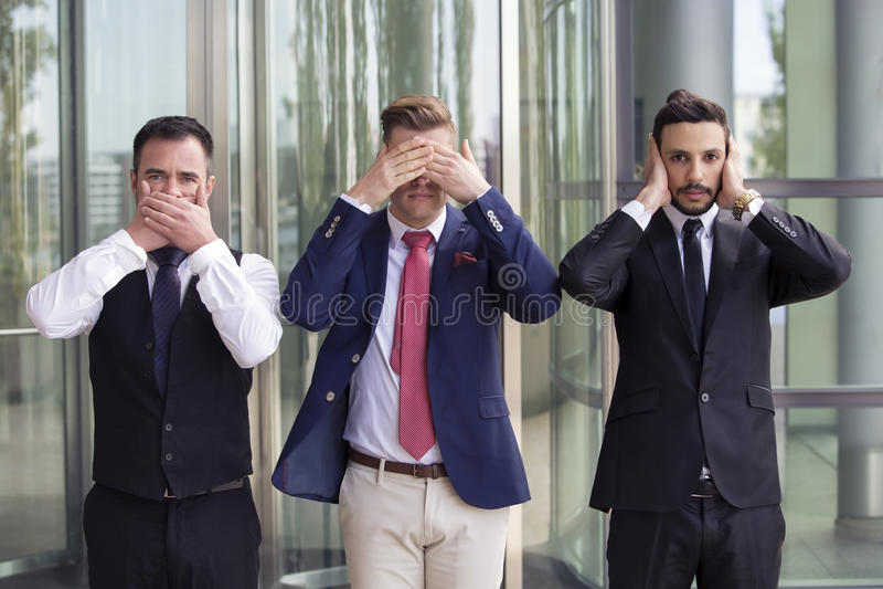 Uomini d'affari bei come le tre scimmie saggie immagine stock libera da diritti
