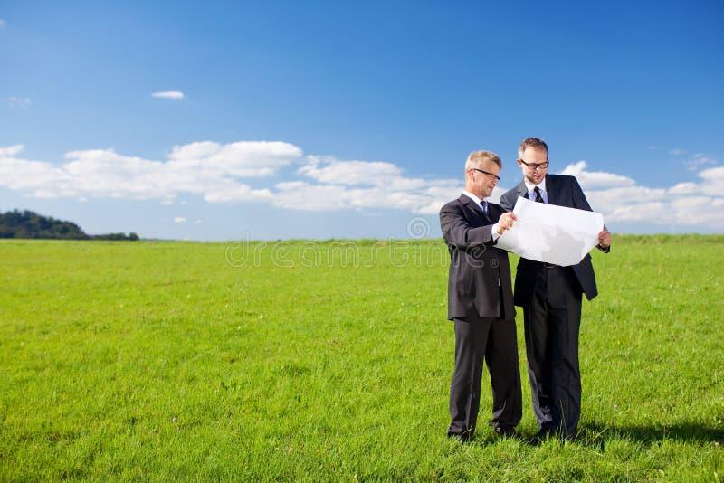 Uomini d'affari di pianificazione immagine stock