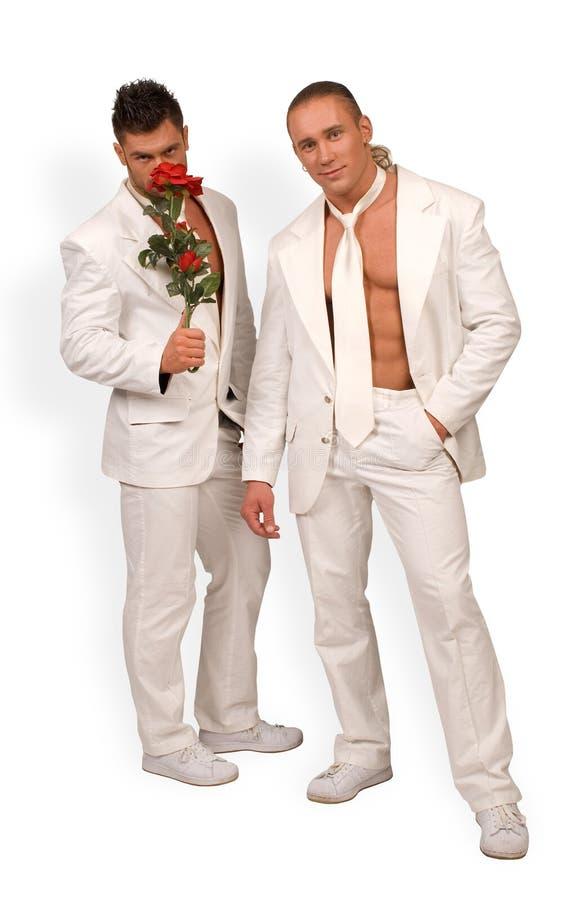 Uomini e una rosa immagine stock