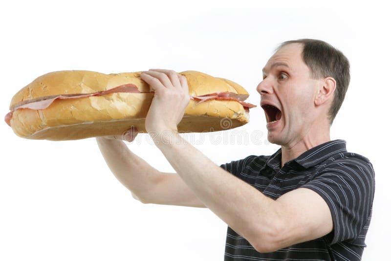 Uomo affamato fotografia stock libera da diritti