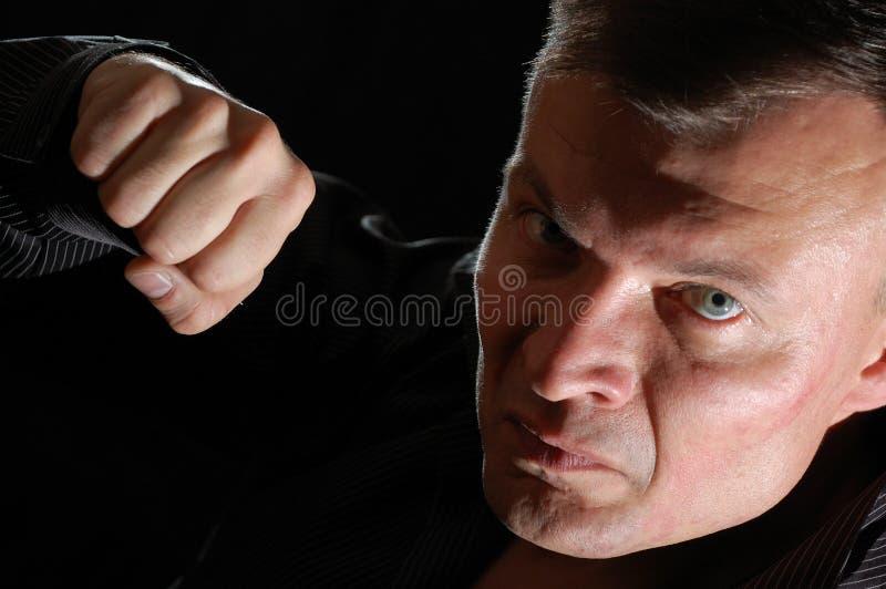 Uomo aggressivo fotografie stock