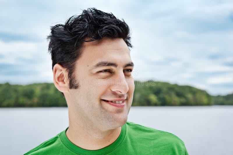 Uomo al ritratto di colpo in testa del lago fotografia stock libera da diritti