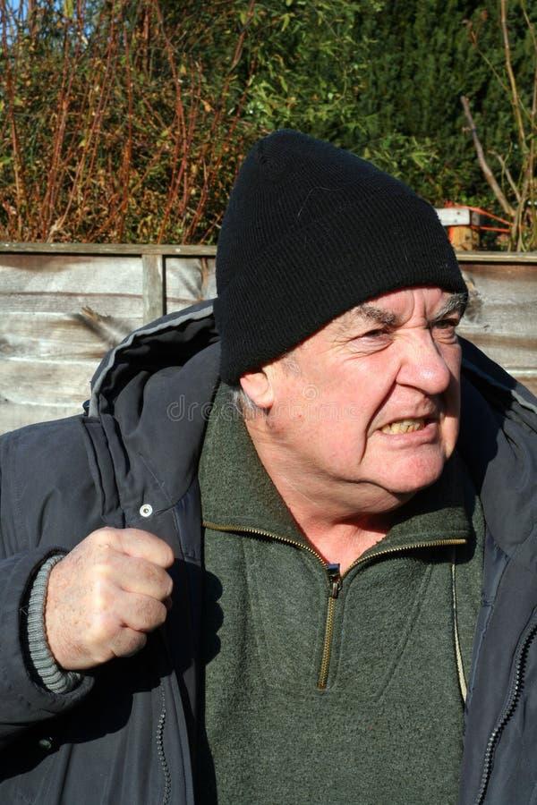 Uomo anziano arrabbiato fotografia stock
