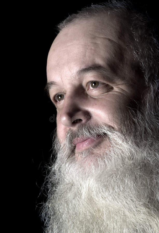 Uomo anziano astuto di sorriso fotografia stock