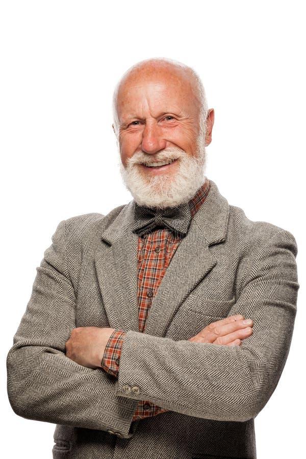 Uomo anziano con una grande barba e un sorriso fotografie stock