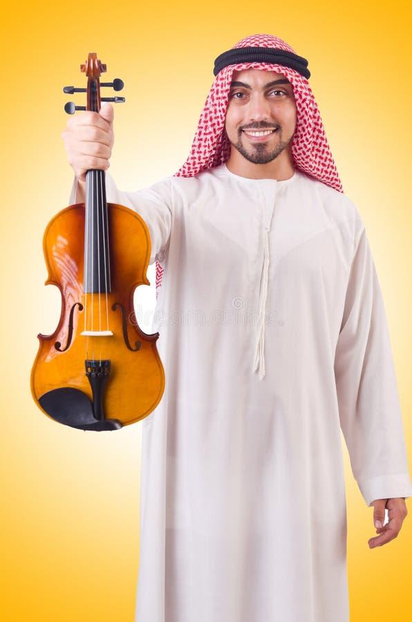 Uomo arabo che gioca musica fotografia stock