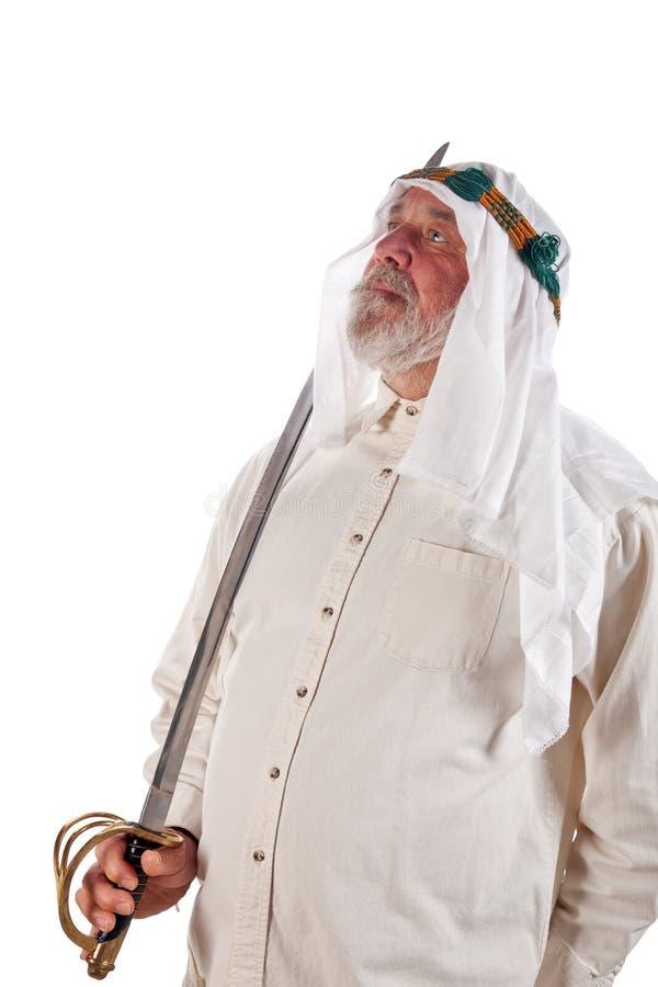 Uomo arabo con una spada fotografie stock libere da diritti