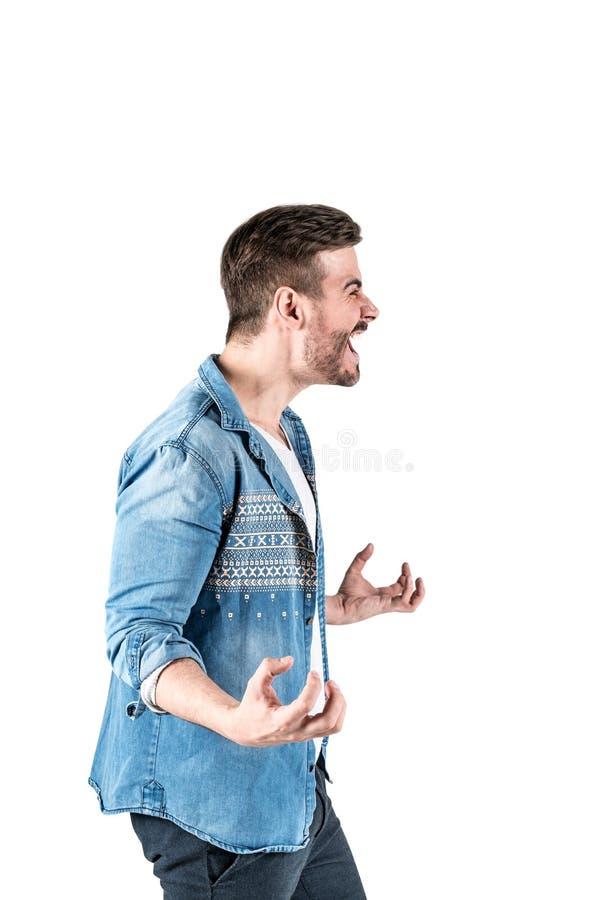 Uomo arrabbiato che mostra una certa emozione di collera immagine stock libera da diritti