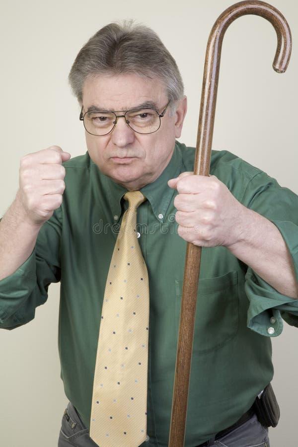Uomo arrabbiato con la canna fotografia stock libera da diritti