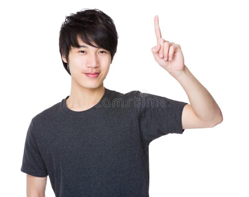 Uomo asiatico con il punto del dito su immagini stock libere da diritti