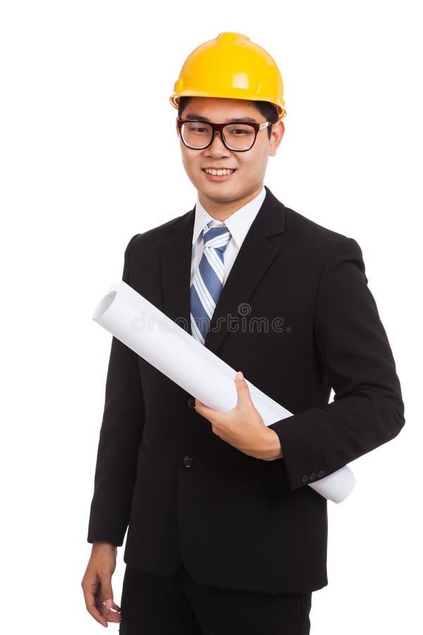 Uomo asiatico dell'ingegnere con i modelli fotografia stock