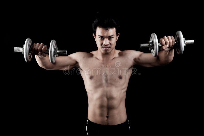 Uomo asiatico muscolare con la testa di legno immagine stock libera da diritti