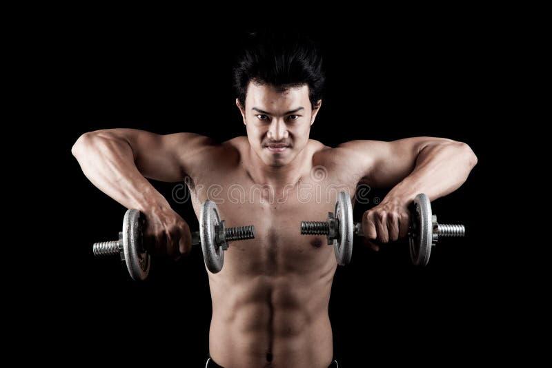 Uomo asiatico muscolare con la testa di legno immagini stock libere da diritti