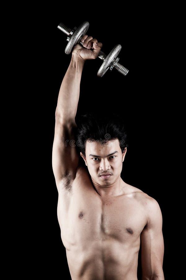Uomo asiatico muscolare con la testa di legno fotografia stock libera da diritti