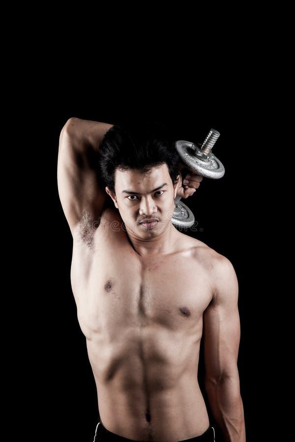 Uomo asiatico muscolare con la testa di legno fotografia stock