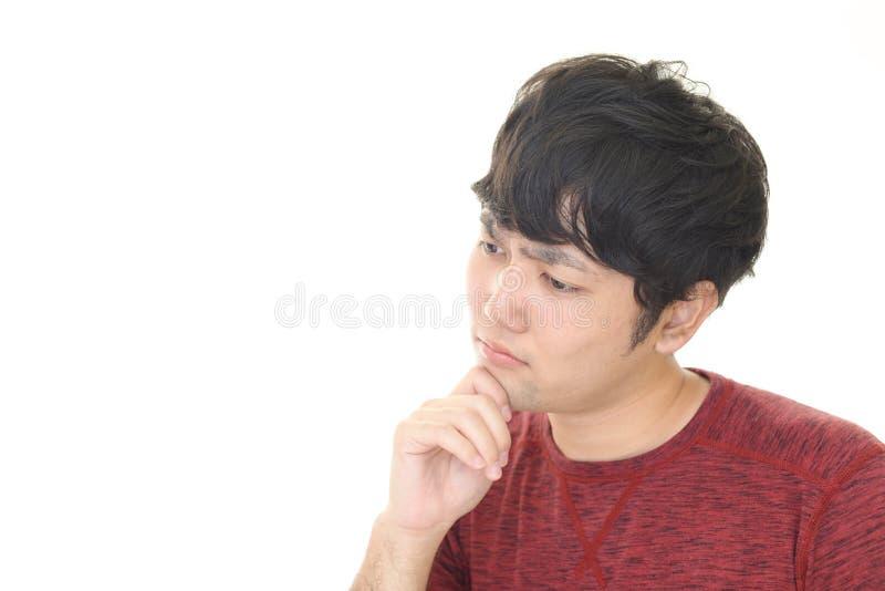 Uomo asiatico stanco immagini stock
