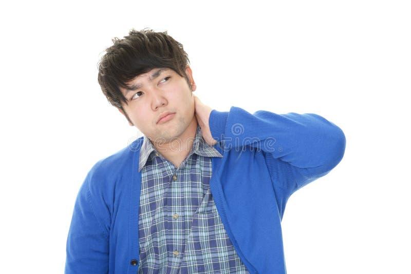 Uomo asiatico stanco fotografia stock libera da diritti