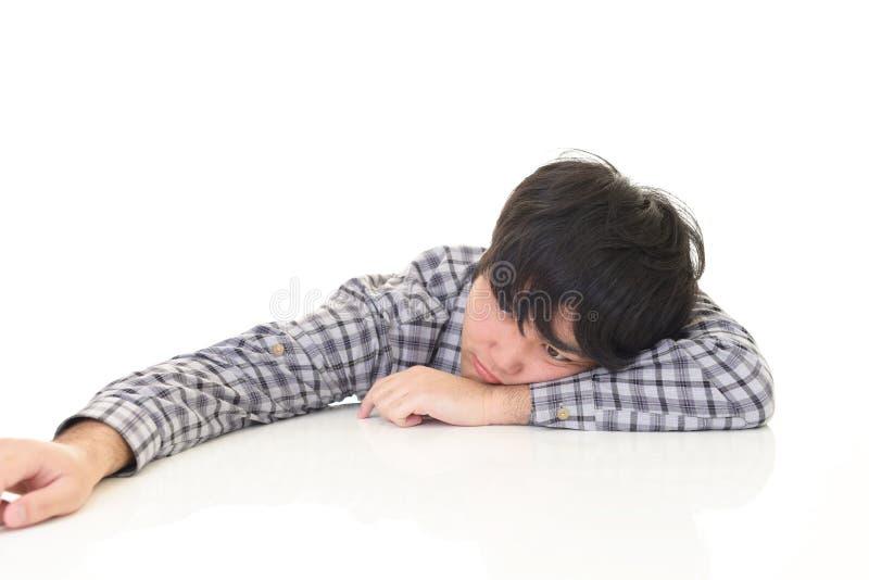 Uomo asiatico stanco fotografia stock