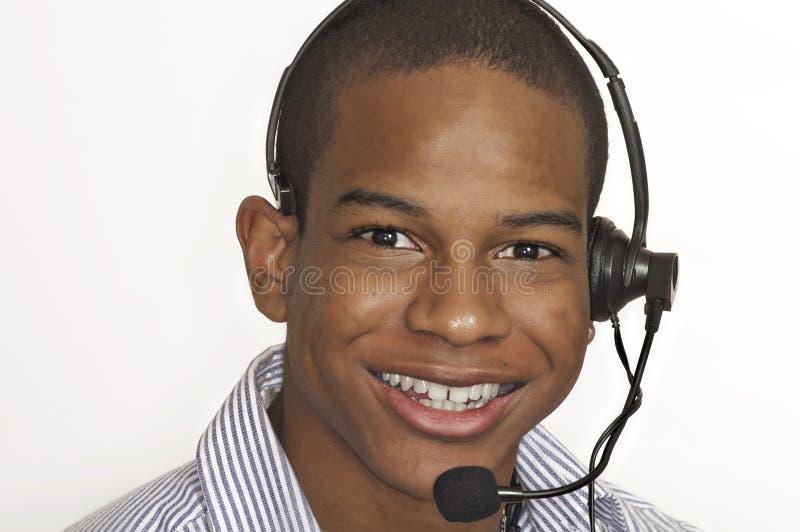 Uomo attraente di servizio di assistenza al cliente fotografia stock libera da diritti