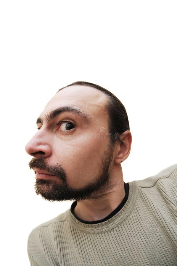 Uomo barbuto caucasico che fa smorfie fotografia stock libera da diritti