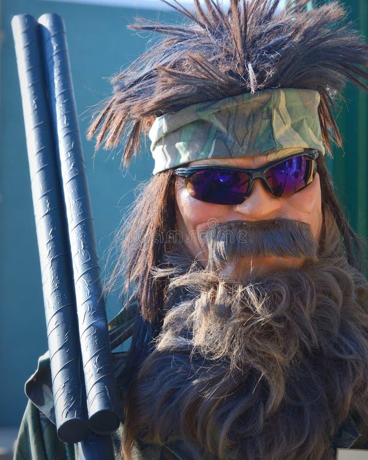Uomo barbuto di caccia dello spaventapasseri immagini stock libere da diritti