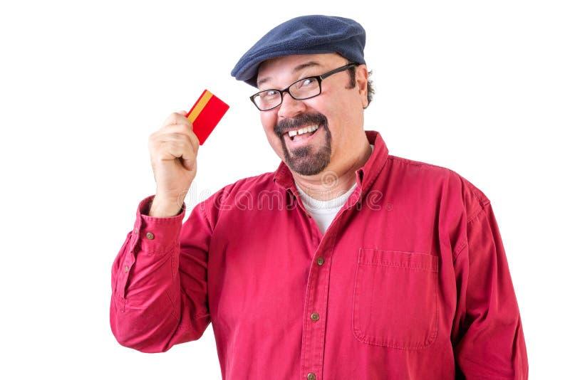Uomo barbuto di mezza età con la sua carta di credito fotografie stock libere da diritti