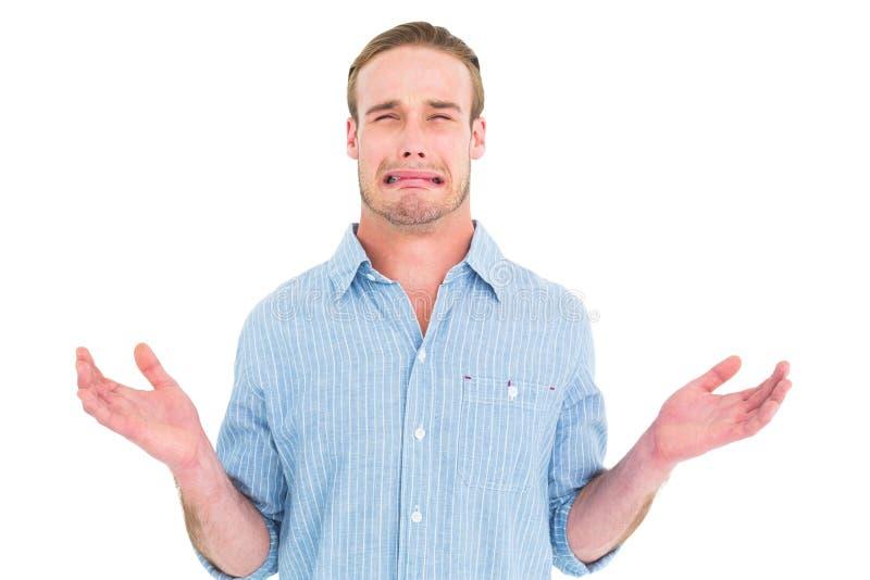 Uomo bello che grida e che gesturing immagine stock