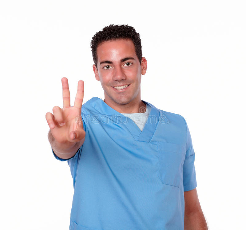 Uomo bello dell'infermiere con il segno di conquista immagini stock