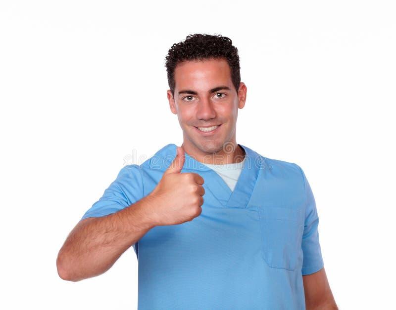 Uomo bello dell'infermiere con il segno positivo immagini stock libere da diritti