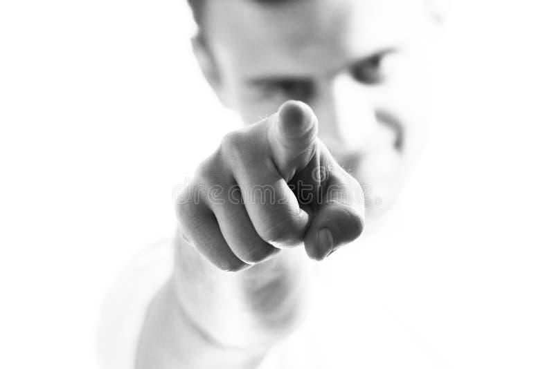 Uomo bello, tipo che indica la parte anteriore, voi, al fondo bianco, chiamata all'azione, motivazione immagine stock