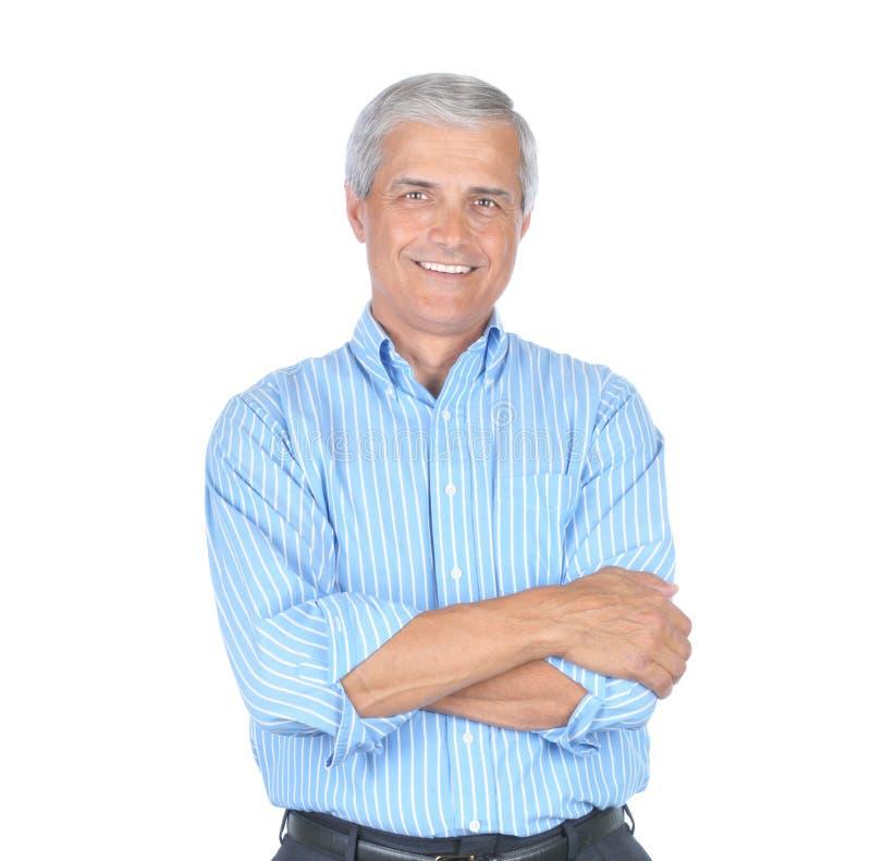 Uomo in braccia blu a strisce della camicia piegate immagine stock