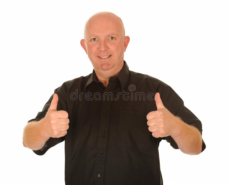 Uomo calvo con i pollici in su fotografie stock libere da diritti