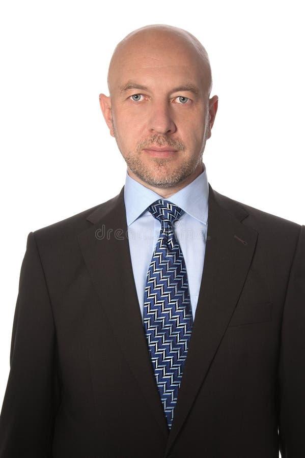 Uomo calvo in un vestito ed in un legame fotografia stock libera da diritti