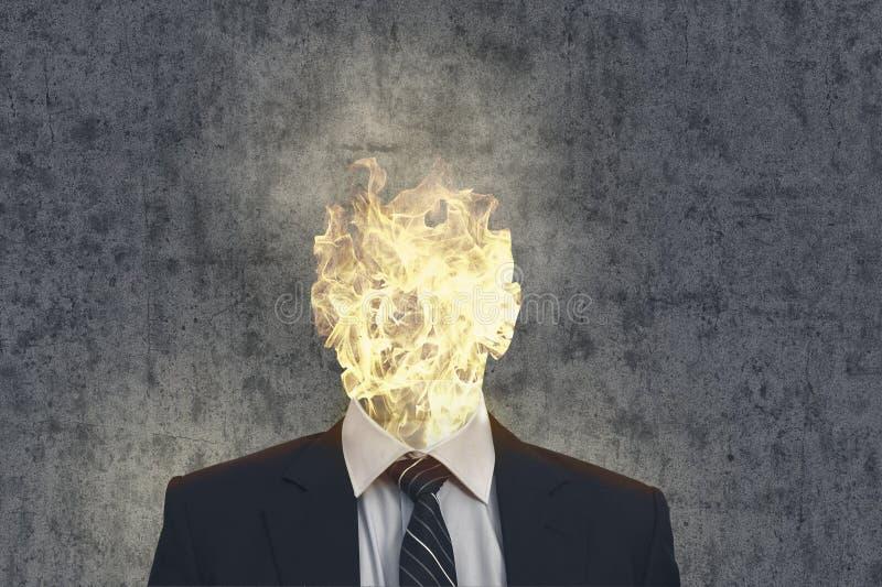 Uomo capo di affari del fuoco immagine stock