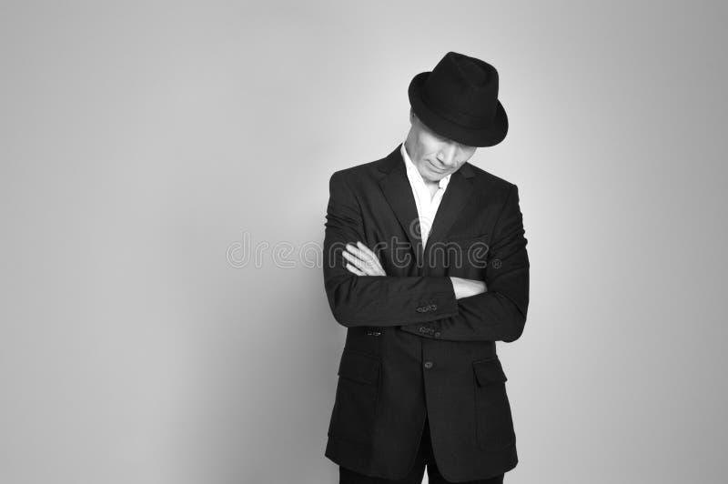 Uomo in cappello nero immagine stock