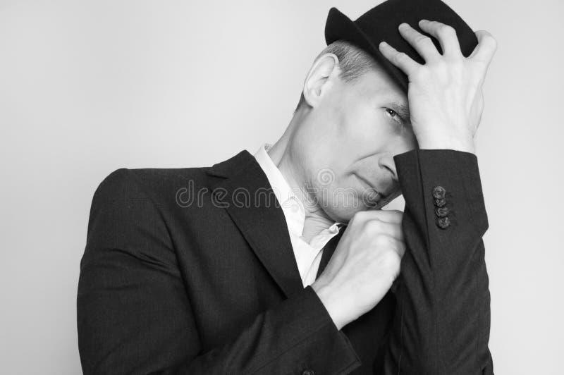 Uomo in cappello nero fotografia stock libera da diritti